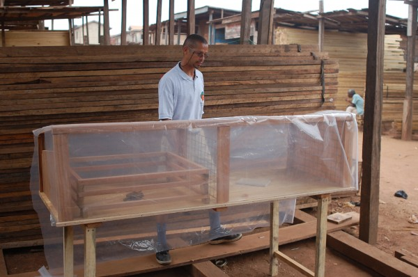 Dominic Wanjihia building the solar dryer he invented.