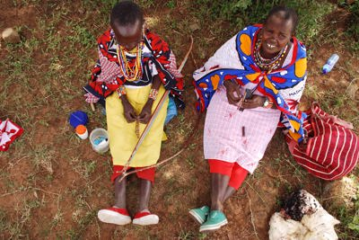 Maasai ladies making beaded works of art Kenya