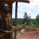 Frederick Msiska with his homemade chemical sprayer.
